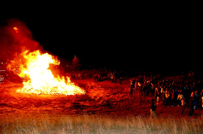 A homecoming bonfire entertained and warmed students Thursday night behind Moffat County High School.