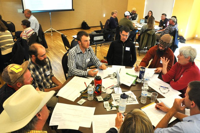 Community members discuss ways to improve the local food economy Thursday at the Steamboat Springs Community Center.