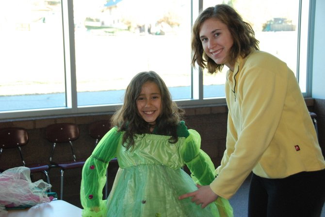 A child tests out a costume at the Green Halloween costume swap in 2011. This year's swap is from 10 a.m. to noon Saturday at Bud Werner Memorial Library.