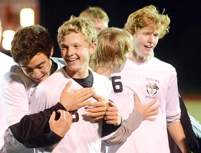 The Steamboat Springs High School boys soccer team celebrates a big win, 1-0, on Thursday night against Summit.