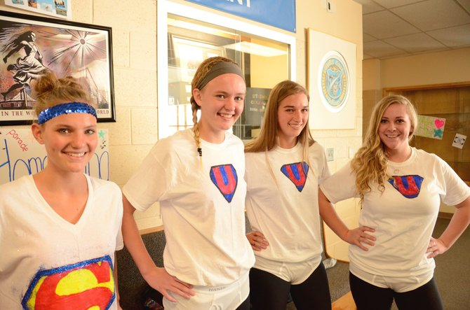 From left, Moffat County High School students Jazmine Swindler, a senior, junior Delaney Baker and seniors Brenna Ciesco and Taylor Dean wear handmade costumes as part of Homecoming week's Superhero/Supervillain Day. Swindler sports the Superman insignia, while the rest are children's book hero Captain Underpants.