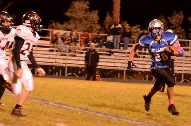 Phillip Chadwick looks to get around the edge Friday at the Bulldog Proving Grounds. Moffat County lost its homecoming game to Montezuma-Cortez, 41-21.