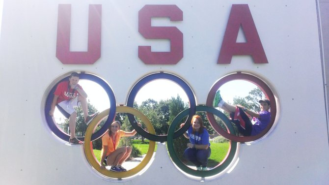Craig teenagers Dakota Ahlstrom, middle right, and Tracer Hickman, far right, pose within the rings of the Olympic Training Center sign in Colorado Springs during the 2013 Triple Play Leadership Summit in September. The event was a learning opportunity for young staff of the Boys & Girls Clubs of America to find new ways to keep children in their clubs active and healthy.
