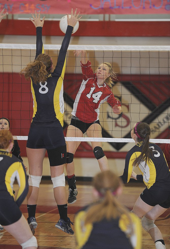 Steamboat Springs senior Mikaila Jegtvig looks to put a point on the board during Friday evening's match against Rifle in Steamboat Springs. It was the final home match of the season for the Sailors, who won in three sets.
