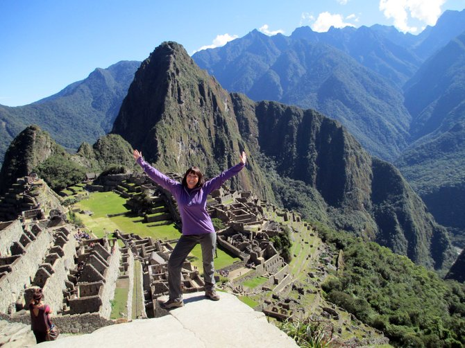 Lisa Schneider poses in front of Machu Picchu in Peru. Schneider spent nearly 20 years as a kindergartner and first grade teacher in Steamboat Springs. Her life changed after being diagnosed with multiple sclerosis and she traveled to world, climbing the highest peak on each of the seven continents. Now she's returning to Steamboat to speak about her journey from fear, soon after her diagnoses, to empowerment.