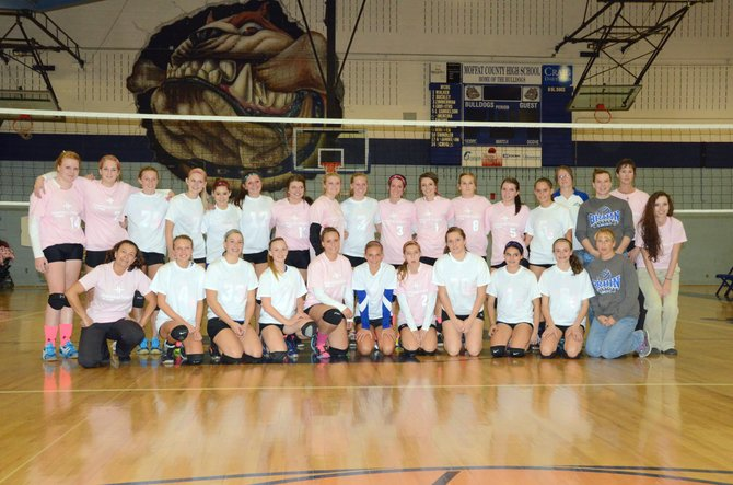 The members of the Moffat County High School volleyball teams wear pink and white shirts donated by The Memorial Hospital as part of Breast Cancer Awareness month at their Oct. 8. The TMH Board of Trustees announced this weekend that it also donated $525 to the Moffat County Cancer Society, buying a signed volleyball autographed by the team.