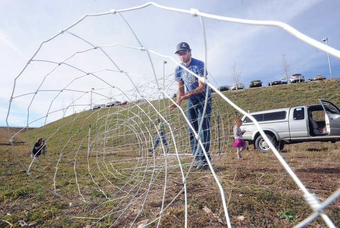 Alex Pond, head of grounds keeping at Colorado Mountain College, unrolls fencing that will be used to help protect beehives from bears. The college beekeeping club, which started last year, is preparing to start hives this spring by building a protected area and planting seeds for mountain lupine and echinacea.