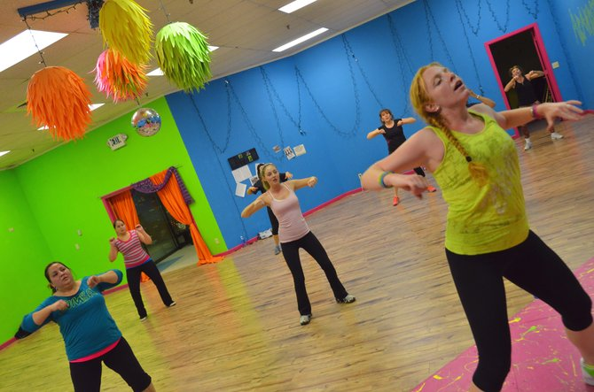 Becky Smith, foreground, lets loose during a Zumba Fitness session at her studio in Centennial Mall. Smith is a licensed instructor for the dance-fitness program, teaching in her own space, as well as at Breeze Street 24-Hour Fitness.