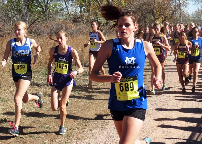 Makayla Johnson runs at the Colorado 3A state championship meet Saturday in Colorado Springs, while teammate Emily Womble, far right, trails her closely. Womble would finish 28th at the meet, Johnson 33rd, and Moffat County's girls cross-country team took fifth overall at the state meet.