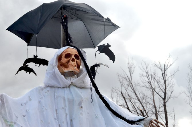 A hooded wraith with rubber bats circling its head haunts passers-by on the lawn of Craig resident Ruth Sanchez. The decoration is one of many spooky seasonal motifs seen at local residences for Thursday's Halloween festivities.