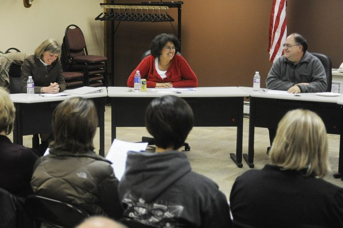 Hayden School Board candidates, from left, Medora Fralick, Sharon Johnson and Brian Hoza, attend a forum Tuesday night at Hayden Town Hall.