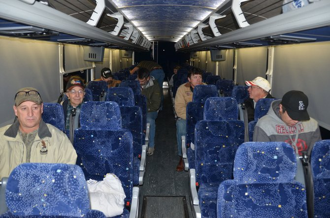 A group of coal miners and power plant workers load a charter bus early Wednesday morning that headed to Denver to rally in support of the coal industry. The bus left the Kmart parking lot in Craig at 6 a.m.