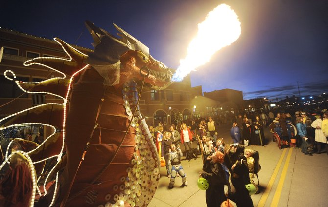 Steamboat Springs resident Charlie Holthausen's dragon spits fire during the Downtown Halloween Stroll in 2012. This year's stroll is from 5 to 7 p.m. in downtown Steamboat.