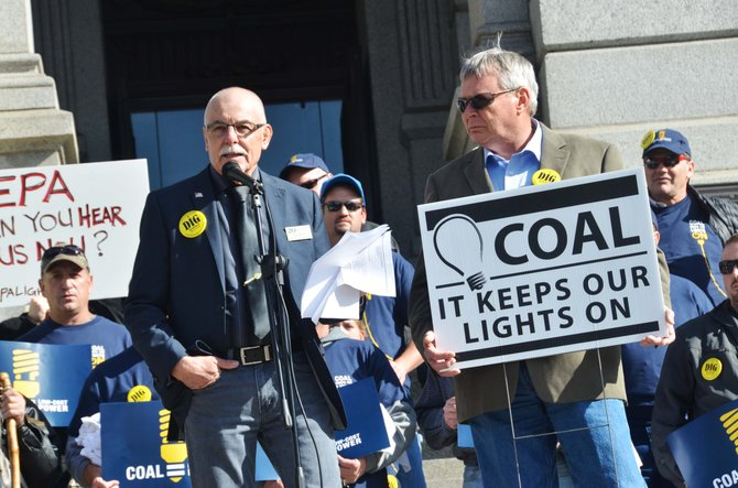 Craig City Council member Ray Beck, left, speaks at the Denver rally in support of coal Wednesday. Moffat County Commissioner Chuck Grobe testified earlier in the day at the Environmental Protection Agency listening sessions, explaining why strict regulations on existing coal-fire power plants could be harmful to the Yampa Valley economy.
