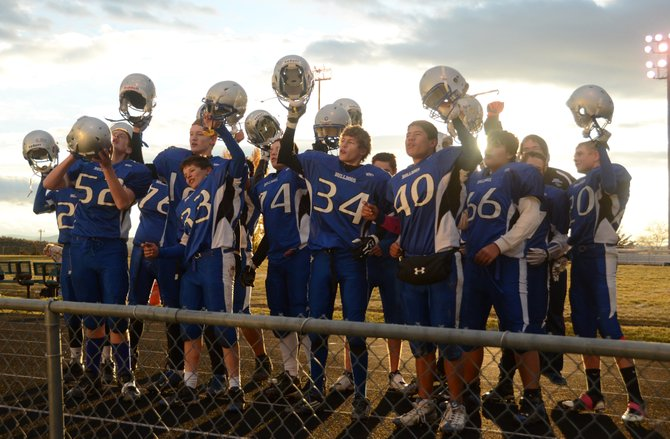 The Moffat County C football team sings the high school fight song to its fans after wrapping up a 42-0 win against Battle Mountain on Thursday at the Bulldog Proving Grounds. The C team finished 8-2 this season.