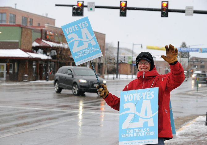 David Scully urges passing motorists Friday to support Referendum 2A on Election Day. All ballots must be received by the Routt County Courthouse by 7 p.m. Tuesday.