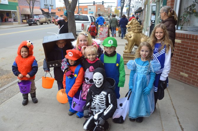 Young trick-or-treaters take time out from getting candy along Yampa Avenue to pose for a picture Thursday afternoon. Hundreds of children and parents flocked to the downtown businesses of Craig to take part in Halloween activities.