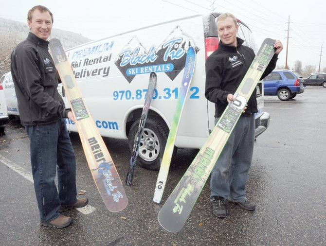Ian Prichard, left, co-founder and president of Black Tie Ski Rentals, and Ryan Simms, director of operations, display custom skis made by Meier, a Glenwood Springs company that makes skis from beetle-killed wood.