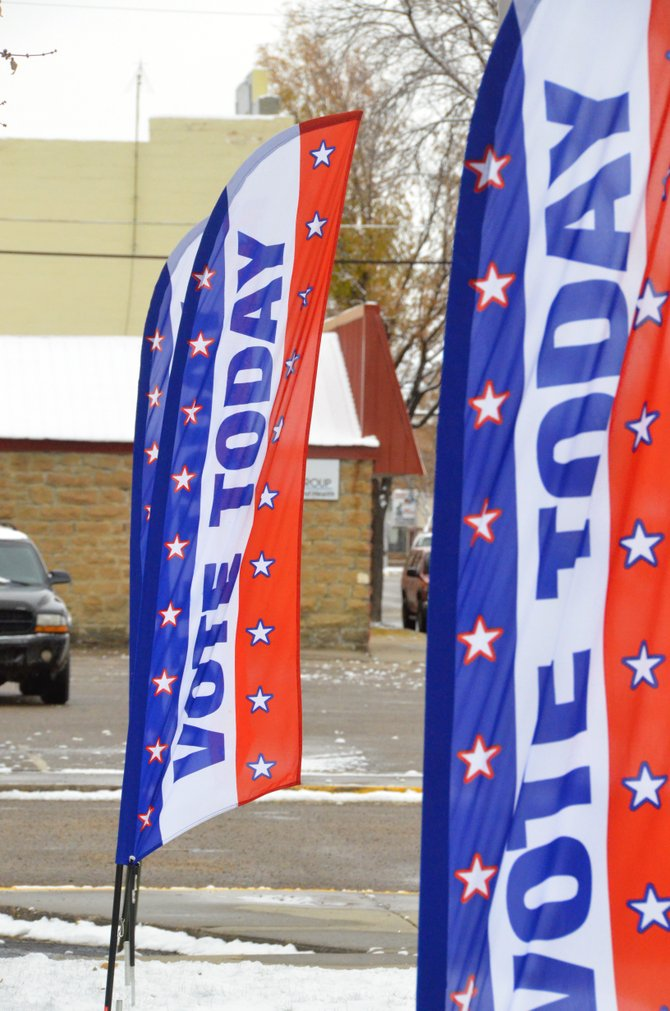 Patriotic banners reminding citizens to vote wave outside the Moffat County Courthouse.