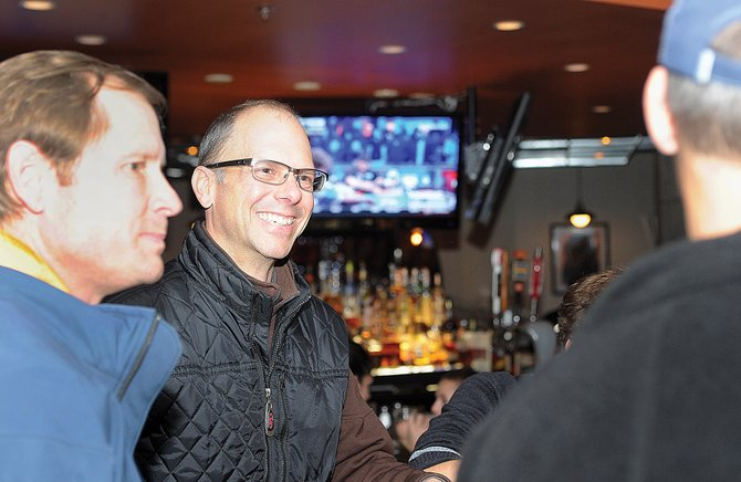 David Scully is all smiles as he visits with a group of Referendum 2A supporters after learning that the ballot referendum had passed Tuesday evening. The group gathered at Carl's Tavern on Yampa Street in downtown Steamboat Springs to celebrate the victory.