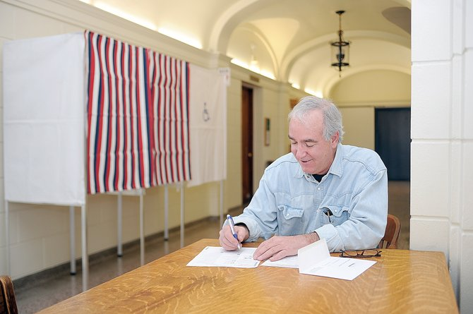 Mark Shillingburg fills out his ballot Tuesday inside the Routt County Courthouse. Officials at the elections office said a steady stream of voters were coming through the doors Tuesday to drop off ballots and cast their votes in the 2013 election.
