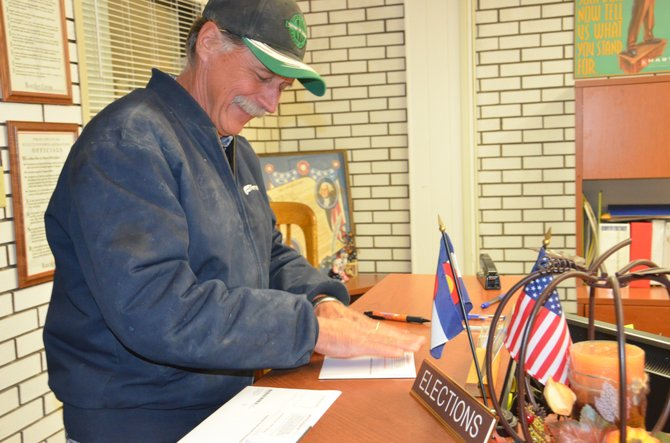Al Grieser seals his mail-in ballot Tuesday at the Moffat County Courthouse, moments before he cast his vote.