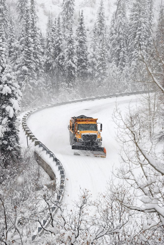A snowplow works its way up Burgess Creek Road on Wednesday morning. Heavy snow made driving conditions difficult and kept plows busy trying to keep up with the falling snow.