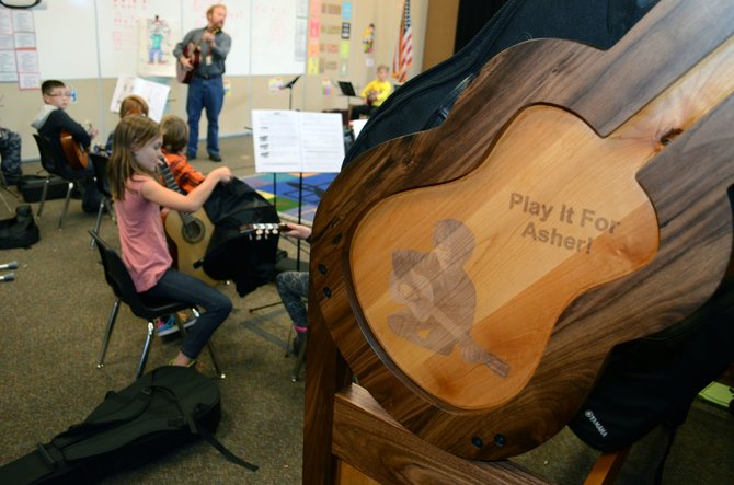 Inside Soda Creek Elementary School, music teacher Jake Gasau's room now has a handcrafted guitar stand built by Jim Lambert via various donors in Asher Lesyshen-Kirlan's memory. An identical guitar stand also is at Strawberry Park Elementary School.