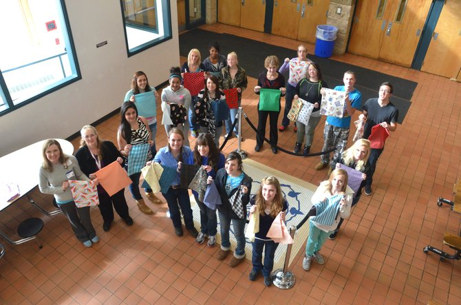 The students of Moffat County High School's Family and Consumer Science program hold up the specially made pillowcases collected by Christine Marks-Neece, far left. The MCHS class donated 27 pillowcases made by students to The Memorial Hospital for use by abdominal surgery patients.