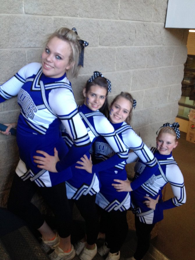 Moffat County cheer team members Tiera Reeves, Makayla True, Chandra Warren and Cassidy Griffin for cheered the football team all fall and are now preparing to pump up the crowd and the basketball teams in the coming months.