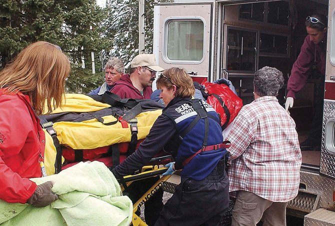Charles Horton is loaded into an ambulance after being rescued from an area near Chapman Reservoir in rural northeast Rio Blanco County in 2005. A TV show about his experience is scheduled to air Monday.