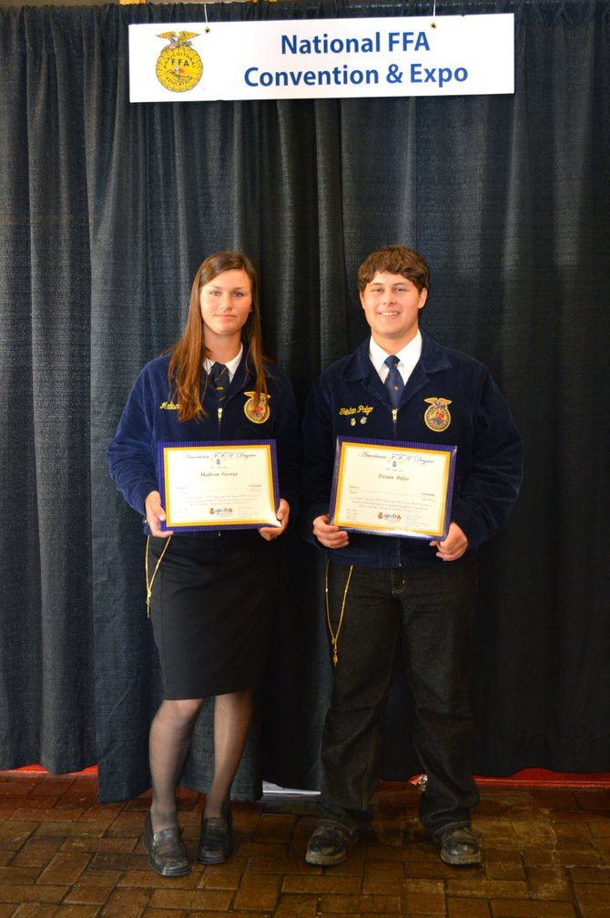 Madison George, left, and Tristan Palyo received their American FFA Degrees at the National Convention & Expo in Louisville, Ky., two weeks ago. The two are 2012 Soroco High School graduates and spent hours of time and labor to achieve the honor.