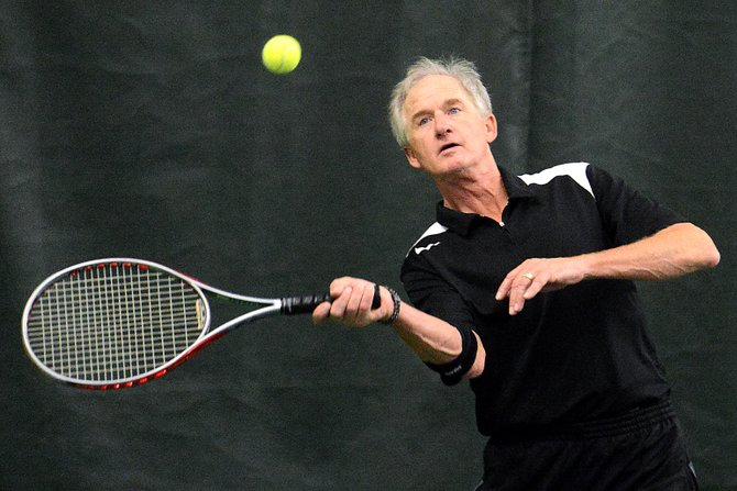 Jim Simon squares up a ball Sunday during the Steamboat City Championship tennis tournament. He joined Mike Ramsey to win the men's 3.5 doubles bracket.