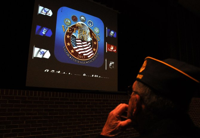 Veteran Bob Hayes watches a presentation celebrating local veterans on Monday at Hayden High School.