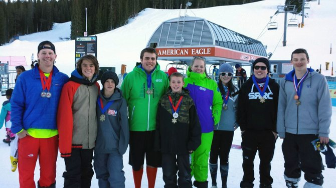 From left, Tommy Boldt, Billy Winters, Cody Winters, Garrett Denney, Winston Vaughan, Katie Keough, Maggie Carrington, Ezio Argento and Conrad Sacher show off their medals after the Winter Sports Club's first race at Copper Mountain Sunday.