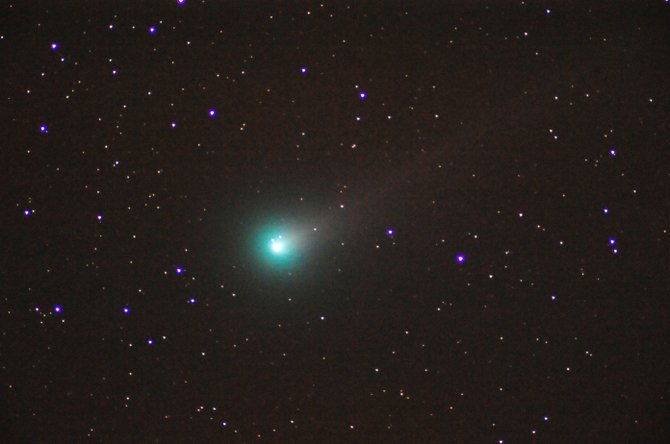 Comet Lovejoy now is at the naked-eye limit and getting brighter while Comet ISON struggles to become a binocular object. In this telescopic image, taken at 4:03 a.m. Sunday from Stagecoach, Comet Lovejoy sports a faint yellowish dust tail and a glowing green coma. Both comets should continue to brighten through November in our predawn sky.