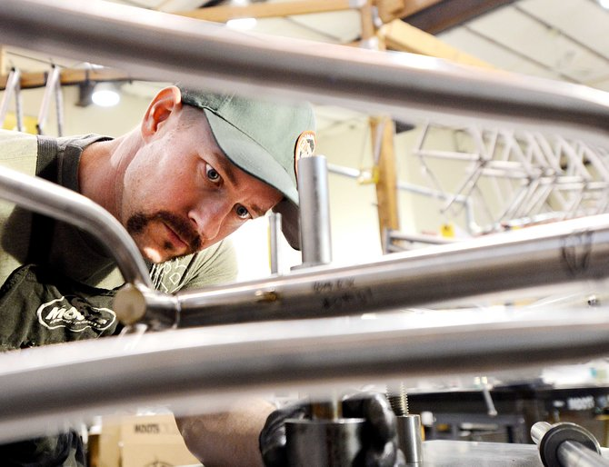 Blake Chilson aligns the frame on a new Moots bicycle Wednesday at the Steamboat Springs manufacturer. The IMBA World Summit is headed to town next summer. The event is expected to draw at least 400 people, many traveling from IMBA chapters around the world.