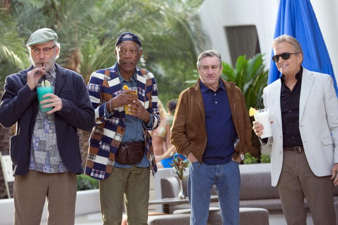 "Sam, Archie, Paddy and Billy (Kevin Kline, Morgan Freeman, Robert De Niro, Michael Douglas) grab a drink poolside in ""Last Vegas."" The movie is about four longtime friends who meet in Las Vegas for a bachelor party for the only one who hasn't married."