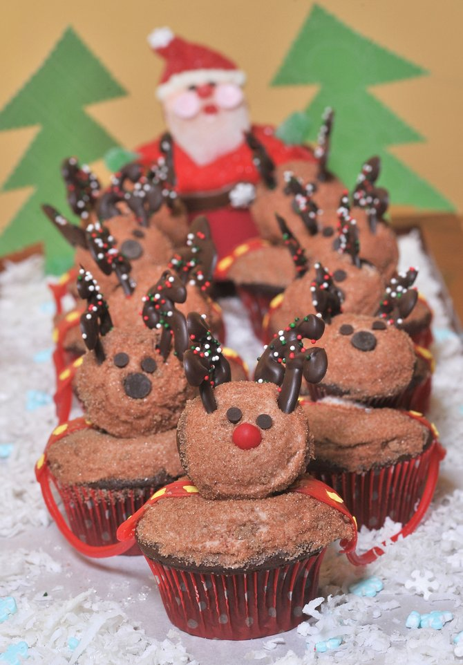 Liz Meissner's Santa on his Way Cupcakes won Best Presentation at the 2012 Holliday Dessert Bake-Off. Recipes are due Friday for this year's baking contest.
