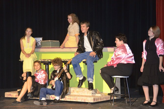 "The members of Rydell High's T-Birds and Pink Ladies convene in the Moffat County High School production of ""Grease."""