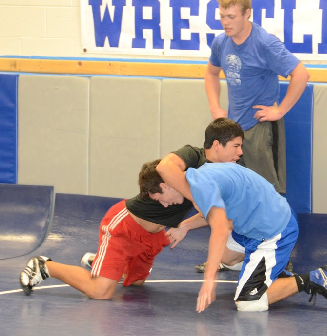 Hugo Hernandez, back left, does wrestling drills on teammate Shandon Hadley at practice Friday. Hernandez is part of a large entering freshman class that brings added depth to Moffat County wrestling for the 2013-14 season. The Bulldogs also return state qualifiers Issic Herod, Brayden Peterson and Jesse Demoor.