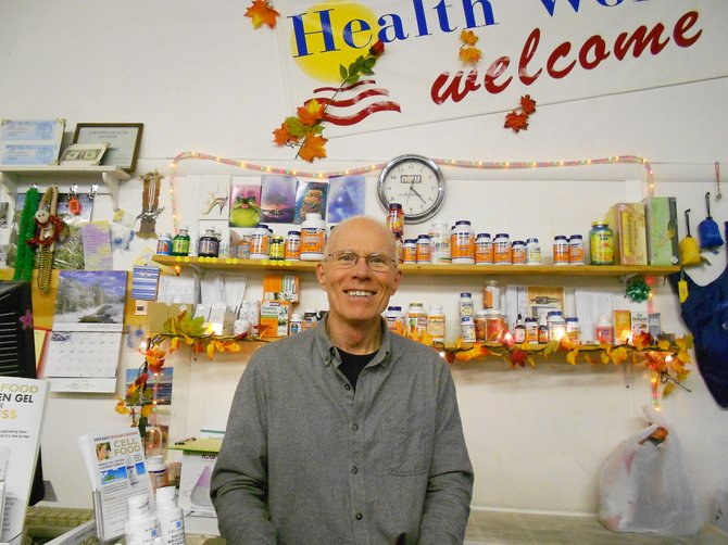 Health Works owner Daniel Wright stands at the counter of his health store in Craig. Wright sells a variety of probiotics in his store.