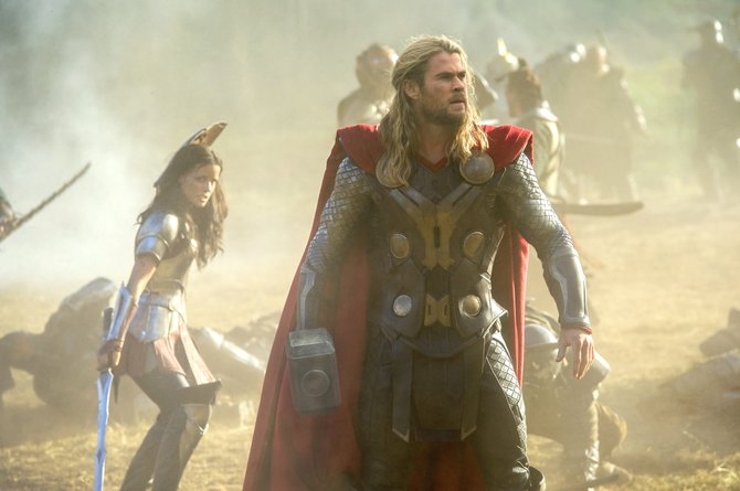 "Thor and Sif (Chris Hemsworth, Jaimie Alexander) survey an Asgardian battlefield as the dust clears in ""Thor: The Dark World."" The movie is about the further adventures of the Marvel Comics character and member of The Avengers as he balances his time between his home world and Earth."