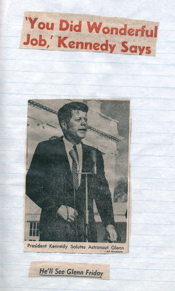 After astronaut John Glenn orbited the earth in Friendship 7 in February 1962, writer Tom Ross pasted newspaper clippings showing President John F. Kennedy expressing his praise for Glenn into  a school report. Less than a year later, Kennedy was shot and killed in Dallas.