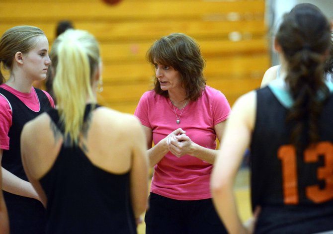 Hayden girls basketball coach Michelle Wilkie talks with her team after practice Friday night. The Tigers hope to build this season after winning just four games last winter.