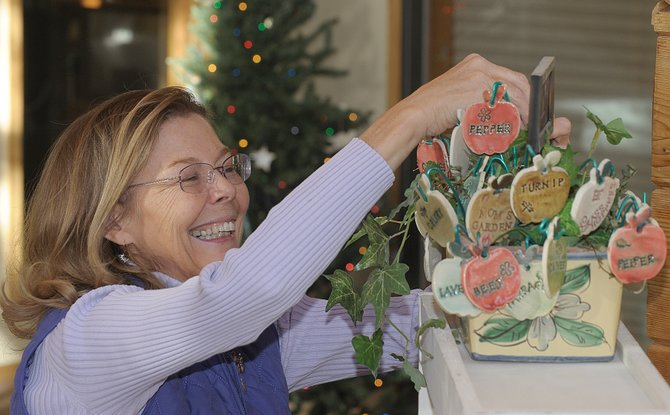 Deb Babcock, owner of Blue Sky Pottery, sets up for the Steamboat Clay Artisans holiday pottery sale, which will take place Friday and Saturday.