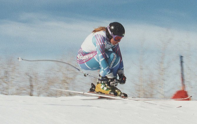 Sunshine Owens races down the slopes during a downhill competition at Steamboat Ski Area when she still was a member of the Steamboat Springs Winter Sports Club.
