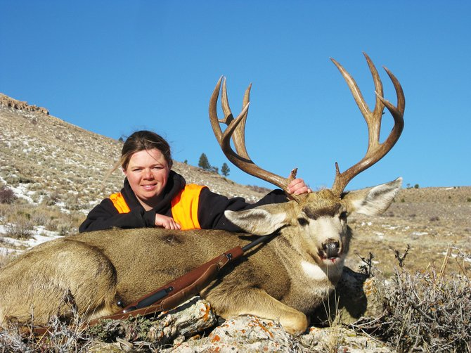 "Tori Pingley shows off her mule deer this hunting season. This photo was submitted in the Craig Daily Press Hunting Photo Contest. The contest is now closed, but the newspaper needs the your help judging the photos. Go to the Craig Daily Press Facebook page and click ""like"" on your favorite photo. The photo with the most likes will receive a $250 gift card to Murdoch's."
