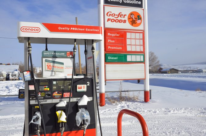 The gas pumps and sign at Go-fer Foods, as well as a note in the front window, indicate the store has closed. Owner Monument Oil, of Grand Junction, shut down the business Tuesday.