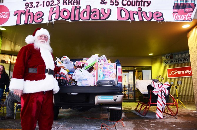 The KRAI and 55 Country Holiday Drive brought in a heap of donations Thursday, and the volunteers anticipate they will see plenty more on Friday.